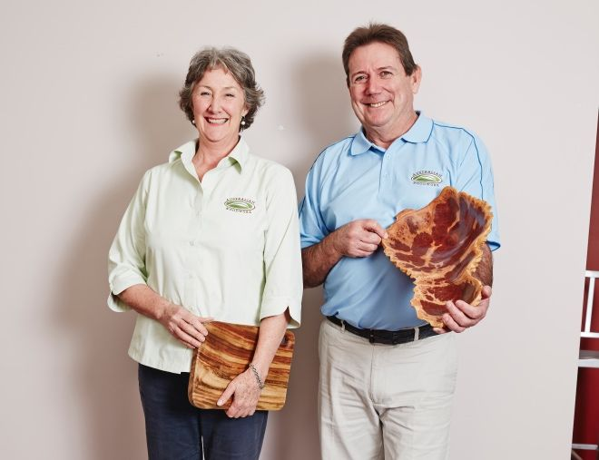 Australian Woodwork's founders, Sarah and Greg, showing off handcrafted bowls.