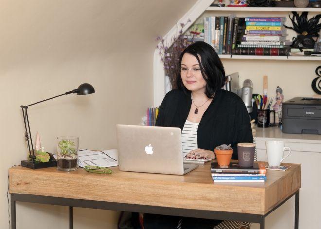 Lindsey Redinger of InVision working at her desk